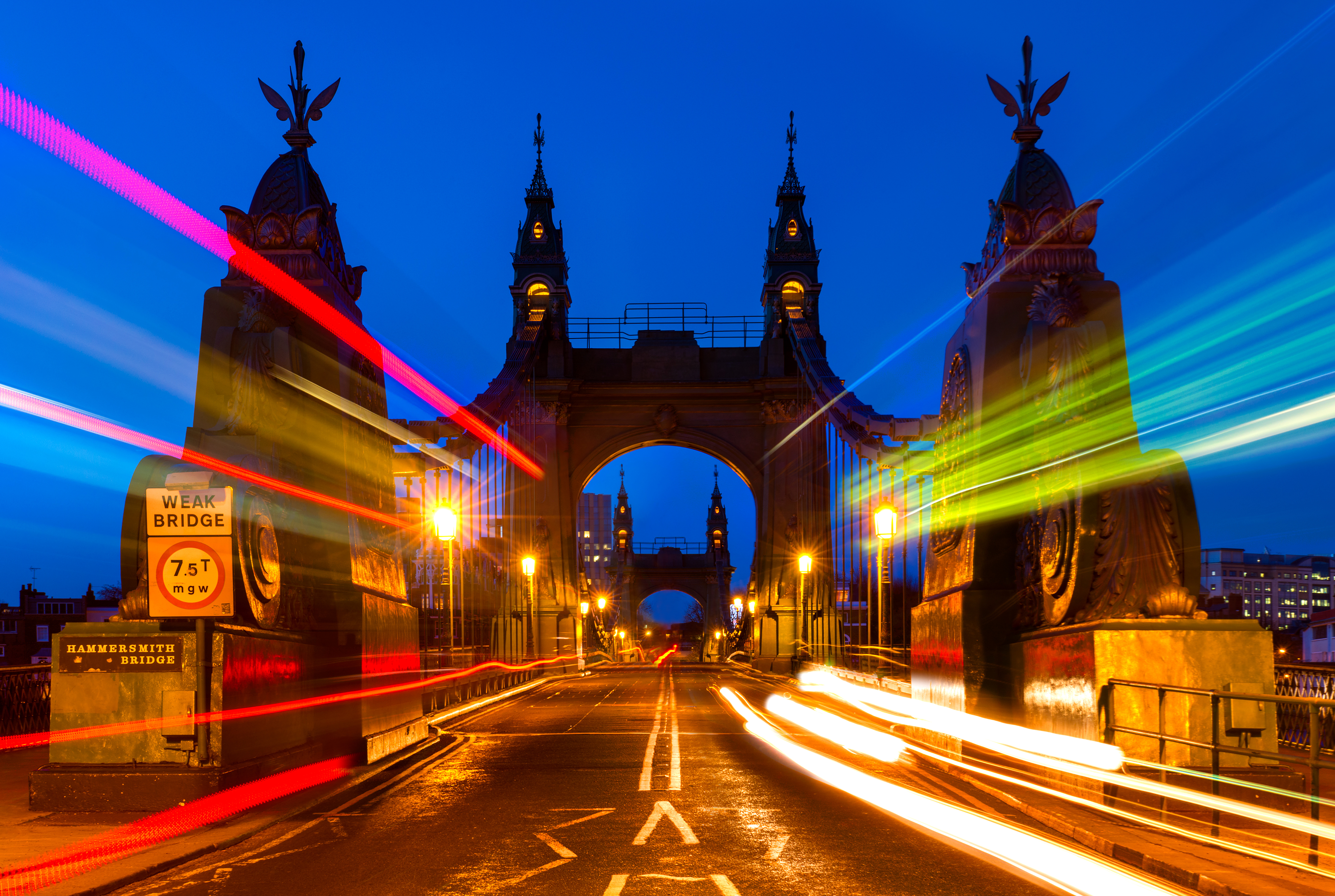 Hammersmith bridge with glowing lines and lights at night